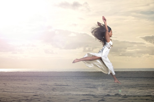 Beautiful African Girl Jumping in White Dress